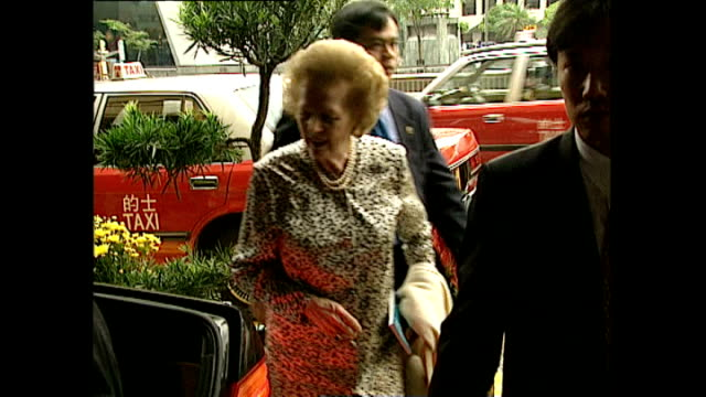 exterior shots of baroness margaret thatcher and her husband dnis thatcher arriving at a hotel ahead of the transfer of sovereignty over hong kong... - baroness stock videos & royalty-free footage