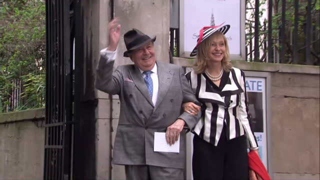 exterior shots of barry humphries lizzie spencher pose for photo op before entering st brides church for the wedding of rupert murdoch and jerry hall... - rupert murdoch stock videos and b-roll footage