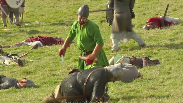 exterior shots of battle of hastings reenactment enthusiasts in period costume taking part in a staged battle to mark the 950th anniversary on... - battle of hastings stock videos & royalty-free footage