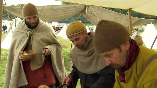 exterior shots of battle of hastings reenactment enthusiasts in costume before taking part in a mock battle on october 15 2016 in hastings england - battle of hastings stock videos & royalty-free footage