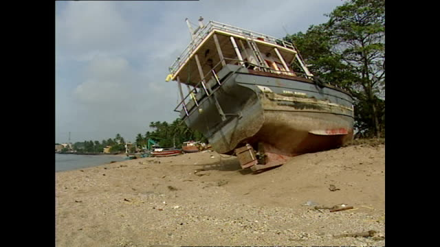 exterior shots of beached and damaged fishing boats washed up in the aftermath of the tsunami in hambantota>> on january 01 2005 in hambantota sri... - 2004 indian ocean earthquake and tsunami stock videos & royalty-free footage