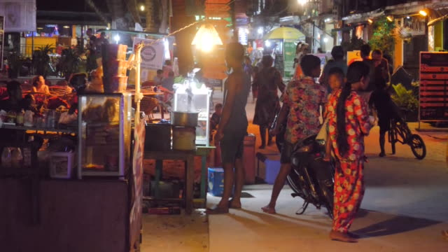 vídeos de stock, filmes e b-roll de exterior shots of beaches and streets on the island of koh rong where the search for british backpacker amelia bambridgeis taking place on 31 october... - cambodia