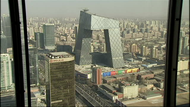 stockvideo's en b-roll-footage met exterior shots of beijing skyscrapers including the cctv headquarters and china world trade center tower from a window of the hyatt hotel on january... - hyatt