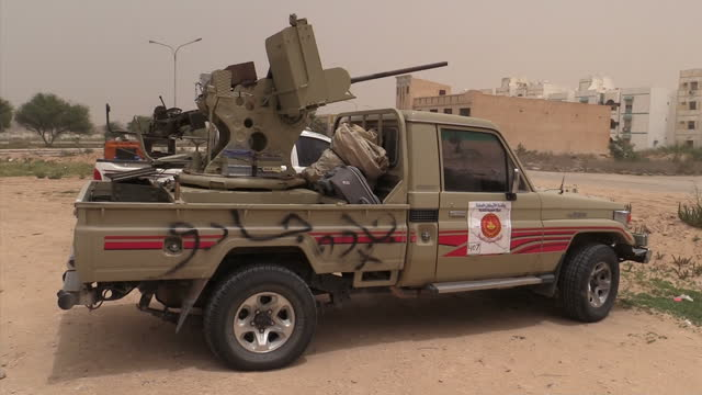 exterior shots of berber fighters at a check point with cars and ammunition car flying a berber flag on june 13 2015 in zuwarah libya - human trafficking stock videos and b-roll footage
