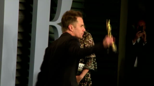 exterior shots of best supporting actor winner sam rockwell posing with his oscar and being joined by leslie bibb on the red carpet at the vanity... - best supporting actor stock videos & royalty-free footage