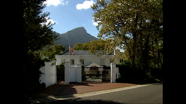 exterior shots of bishop's court, a wealthy residential area of cape town, with wide tree lined roads and large expensive gated houses on april 09,... - wealth stock videos & royalty-free footage