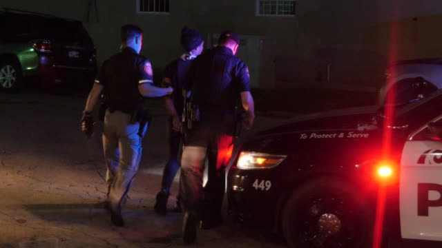 exterior shots of black lives matter protesters being arrested following a curfew on 27 august 2020 in kenosha, wisconsin, united states - waffe stock-videos und b-roll-filmmaterial