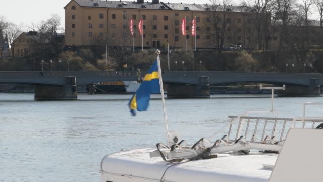 exterior shots of boats moored on stockholms ström on 3 april 2020 in stockholm, sweden - sweden stock-videos und b-roll-filmmaterial
