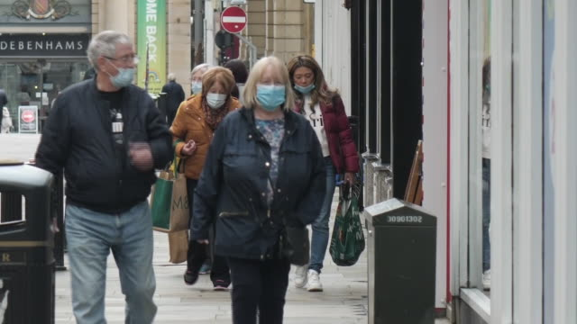 exterior shots of bolton town centre with people walking, many in face masks, with signs warning of the threat of a bolton lockdown and social... - social distancing stock videos & royalty-free footage