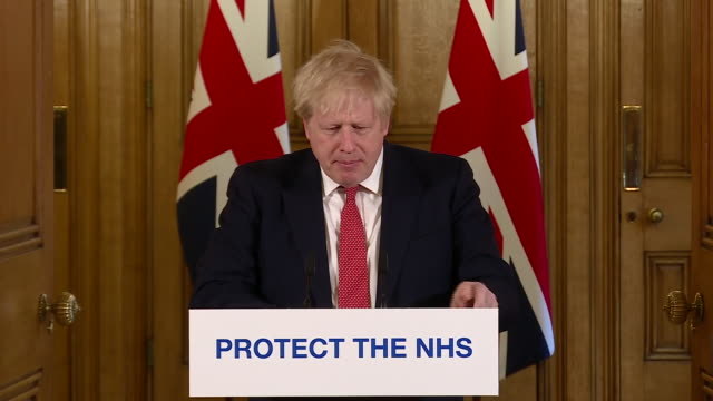exterior shots of boris johnson, british prime minister, giving a daily press conference update on the coronavirus situation in the uk on 20 march... - routine stock videos & royalty-free footage
