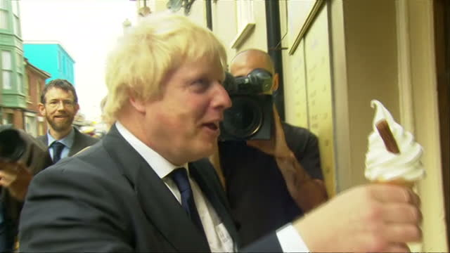 exterior shots of boris johnson campaigning eating ice cream and chatting to local residents ahead of the uk's eu referendum on june 16 2016 in... - norfolk england stock videos & royalty-free footage