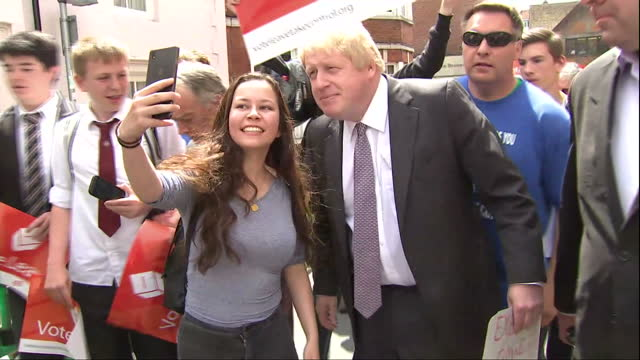 Exterior shots of Boris Johnson greeting crowds of 'Vote Leave' supporters in Winchester being heckled by Vote Remain activists on May 26 2016 in...