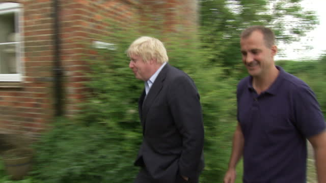 exterior shots of boris johnson jake berry mp walking into boris johnson's house together as the search for a new conservative party leader and prime... - oxfordshire stock videos and b-roll footage