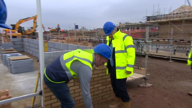 exterior shots of boris johnson laying bricks during the visit to barratt homes' 'willow grove' residential housing development on 21 november 2019... - construction site stock videos & royalty-free footage