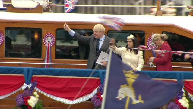 Exterior shots of Boris Johnson waving from Havengore barge on Queen's flotilla during diamond jubilee pageant Boris Johnson waving from Havengore...