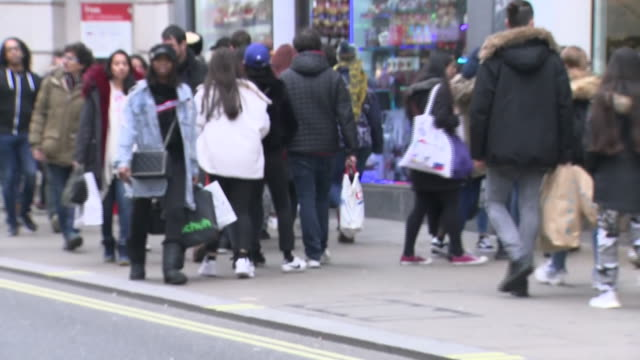 exterior shots of boxing day shoppers walking with bags along oxford street past various stores including jd sports, aldo and office on 26 december... - department store stock videos & royalty-free footage