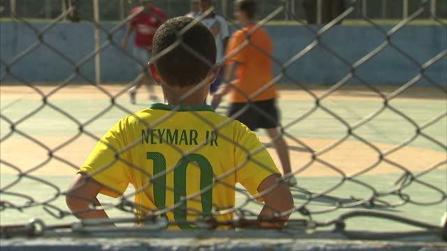 Exterior shots of Brazilian children in Sao Paulo playing a game of football on concrete pitch ahead of England's World Cup clash with Uruguay on...