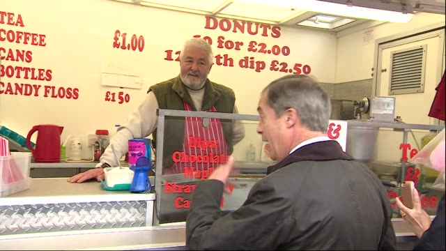 exterior shots of brexit party founder nigel farage meeting a donut seller at a market stall on 10 may 2018 in lincoln, united kingdom - セールスマン点の映像素材/bロール