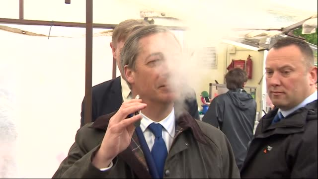exterior shots of brexit party founder nigel farage meeting a market trader on a stall selling vaping products and trying out vaping on 10 may 2018... - nigel farage stock videos & royalty-free footage
