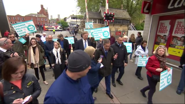 exterior shots of brexit party founder nigel farage on a walkabout of a market in lincoln meeting market traders and shoppers whilst campaigning... - land rover stock videos and b-roll footage