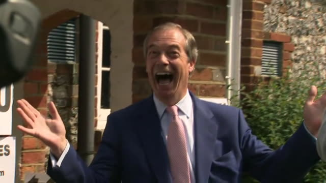 exterior shots of brexit party leader nigel farage posing for photos outside a polling station in bromley after voting in the european elections on... - nigel farage stock videos & royalty-free footage