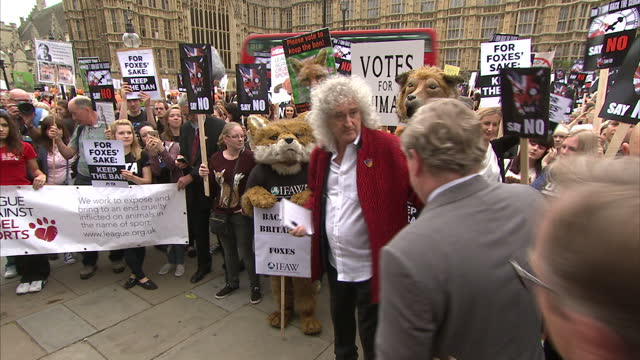 Exterior shots of Brian May former lead guitarist in the rock band Queen posing for photo with Angus Robertson MP Leader of the SNP in the House of...