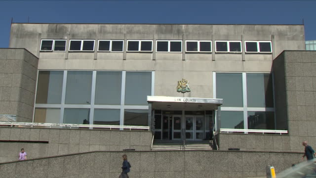 exterior shots of brighton crown court with signage and crest after the sentencing of daryll rowe for intentionally infecting men with hiv on 18... - retrovirus video stock e b–roll