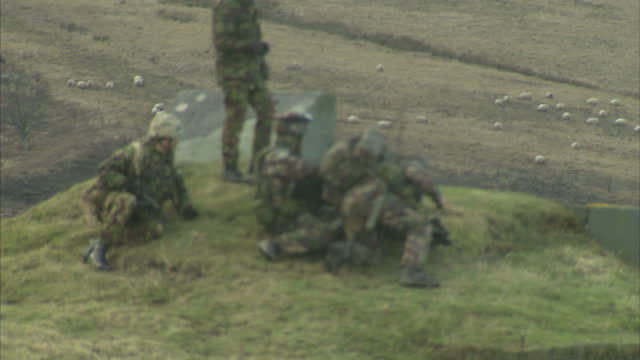 Exterior shots of British and French soldiers engaged in a live firing military exercise in Northumberland French and British war games in...