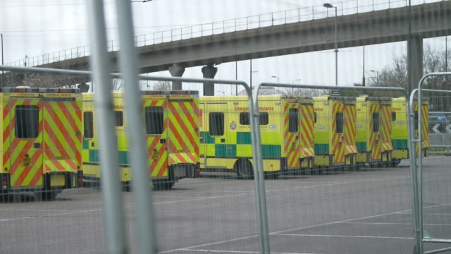 exterior shots of british army soldiers standing next to ambulance's outside the excel london nightingale hospital on 289h march 2020 london united... - army stock videos & royalty-free footage