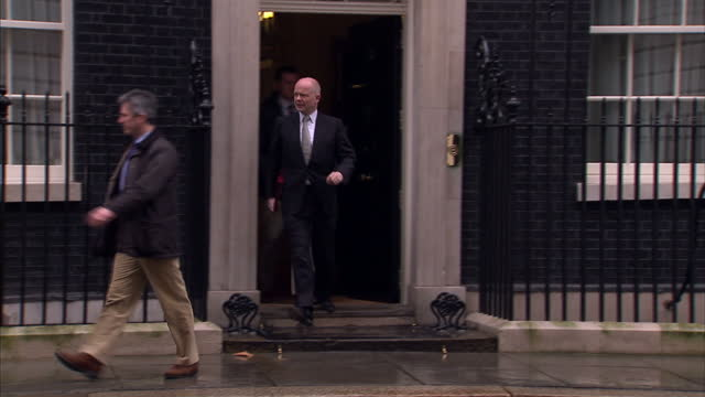 exterior shots of british cabinet ministers leaving downing street after cobra meeting including william hague and dr liam fox british cabinet... - liam fox politician stock videos and b-roll footage