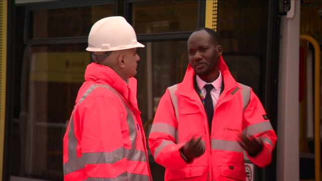 exterior shots of british chancellor of the exchequer sajid javid visits trafford park metrolink line on january 06 2020 manchester england - tram stock videos & royalty-free footage