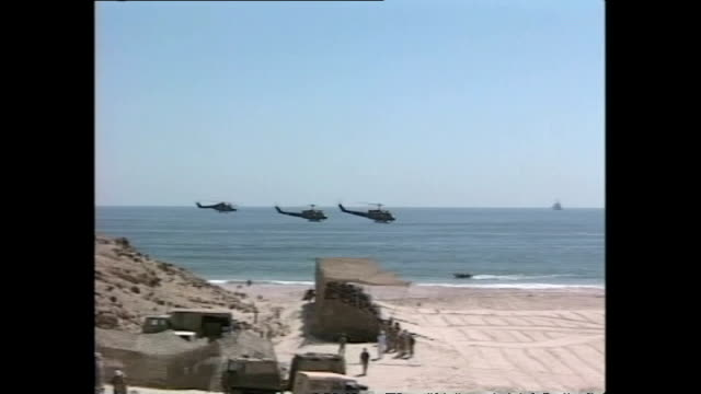 exterior shots of british forces training on a beach in oman with paratroopers landing in the sea and landing craft shortly before action in... - asian tribal culture stock videos and b-roll footage