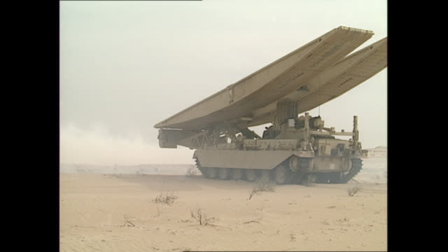 exterior shots of british forces with tanks and other military hardware on a training exercise in the desert as a temporary bridge is laid over sand... - land stock videos & royalty-free footage