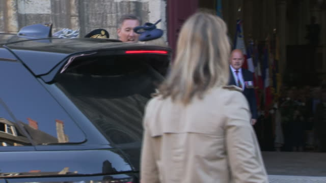 exterior shots of british pm theresa may and lt general james bashall greeting penny mordaunt on arrival at cathedral of bayeux for ceremony to... - d day stock-videos und b-roll-filmmaterial