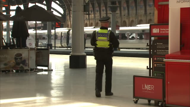 exterior shots of british police officer patrolling inside york train station during the coronavirus epidemic and lockdown on 25th march 2020 york... - railway station stock videos & royalty-free footage