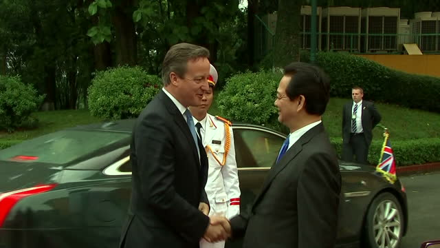 Exterior shots of British Prime Minister arriving at the presidential palace in Hanoi and being greeted by Nguyen Tan Dung Prime Minister of...