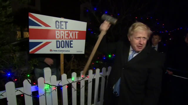 """exterior shots of british prime minister boris johnson putting up sign """"get brexit done"""" on the last day of the general election campaign on 11th... - boris johnson stock videos & royalty-free footage"""