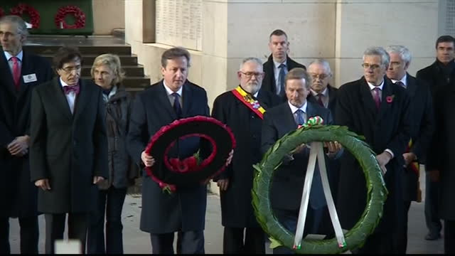 exterior shots of british prime minister david cameron and irish prime minister enda kenny laying wreaths at the menin gate and speaking to buglers... - 戦争記念碑点の映像素材/bロール