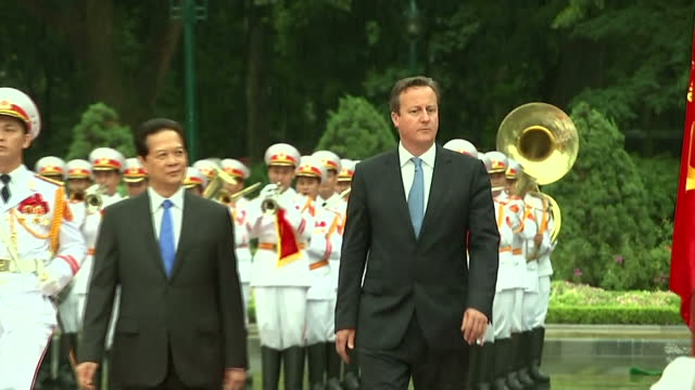 exterior shots of british prime minister david cameron and nguyen tan dung prime minister of vietnam inspecting the honour guard of the vietnamese... - traditionally vietnamese stock videos & royalty-free footage