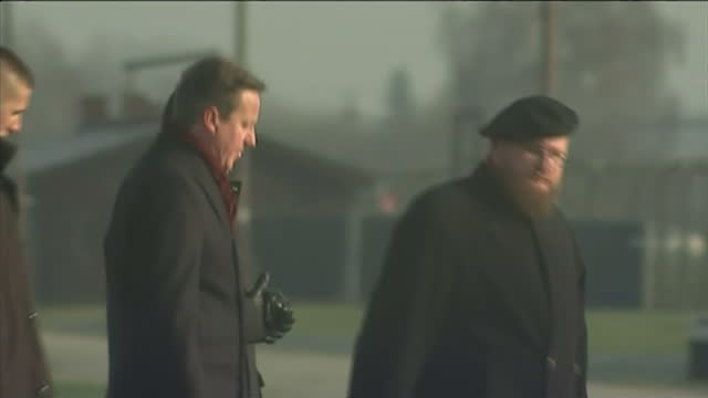 exterior shots of british prime minister david cameron viewing the railway tracks where prisoners arrived at auschwitz during a tour of the former... - david cameron politiker stock-videos und b-roll-filmmaterial