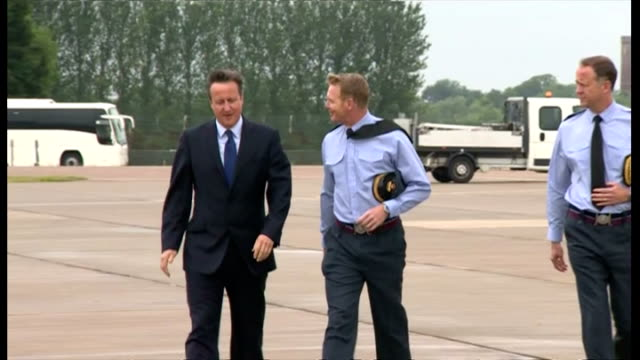 exterior shots of british prime minister david cameron walking across runway of raf coningsby and greeting royal air force pilots on july 13 2015 in... - イギリス国防省点の映像素材/bロール