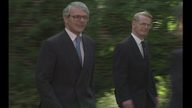 exterior shots of british prime minister john major walking to a microphone in the rose garden in downing street on 23 june 1995 in london united... - prime minister of the united kingdom stock videos and b-roll footage