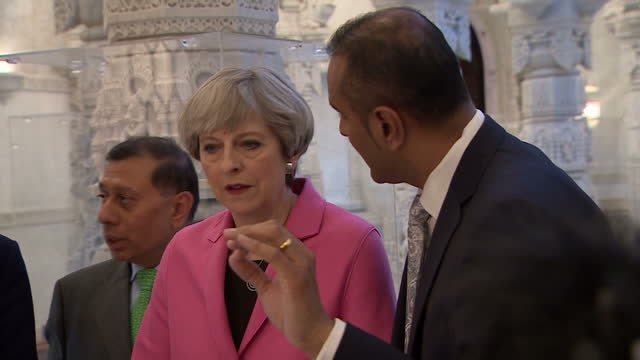 Exterior shots of British Prime Minister Theresa May and husband Philip May visiting the Swaminarayan Mandir in northwest London the largest Hindu...