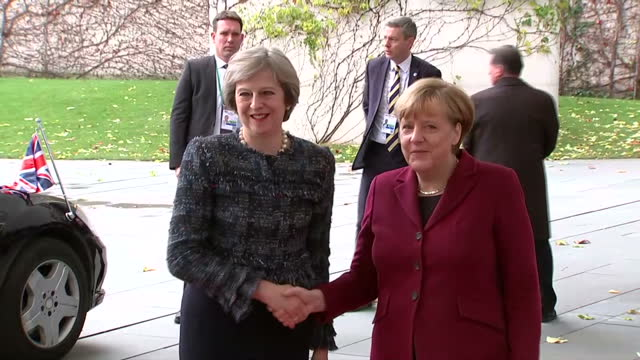 exterior shots of british prime minister theresa may arriving and being greeted by german chancellor angela merkel - アンゲラ・メルケル点の映像素材/bロール