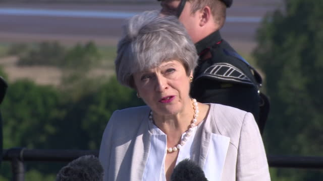 exterior shots of british prime minister theresa may making a speech at a special service at a new war memorial overlooking gold beach marking 75... - d day stock-videos und b-roll-filmmaterial