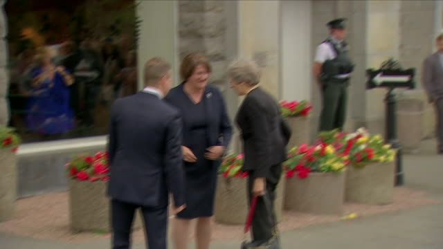 exterior shots of british prime minister theresa may pm arriving in car and is greeted by dup leader arlene foster and entering building on 20 july... - dup stock-videos und b-roll-filmmaterial