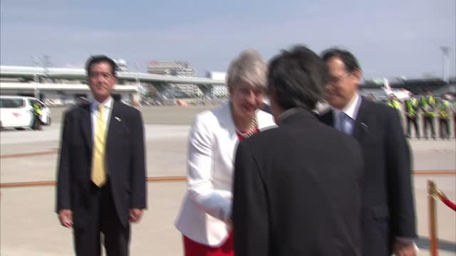 Exterior shots of British Prime Minister Theresa May PM departing RAF and is greeting by officials as she arrives for State visit to Japan on 29th...