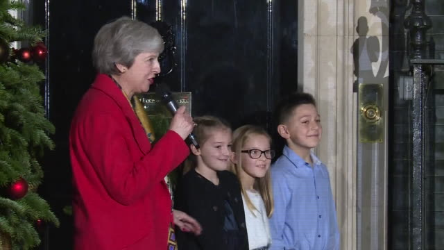 Exterior shots of British Prime Minister Theresa May with children singing hymns outside 10 Downing Street at the lighting of the Downing Street...