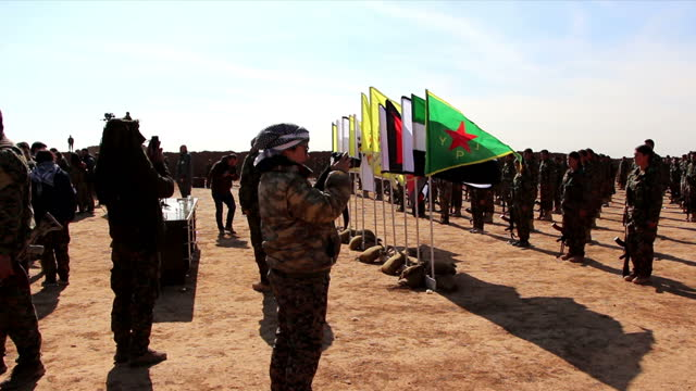exterior shots of british ypj fighter kimberley taylor in the desert talking to her kurdish comrades on 10 february 2017 in kheniz, northern syria. - people's protection units stock videos & royalty-free footage