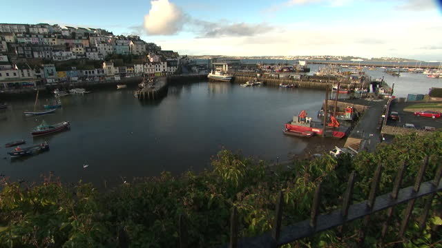 exterior shots of brixham harbour with houses on quayside and fishing boats moored on 3 december 2020 in brixham, united kingdom - waterfront stock videos & royalty-free footage